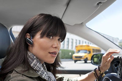 women-wearing-Bluetooth-Earbuds-driving